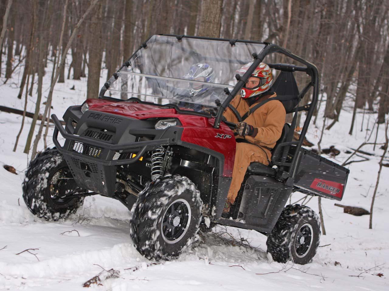 2010.polaris.ranger-xp.seizmik.versa-shield.red_.front-left.riding.on-snow.jpg