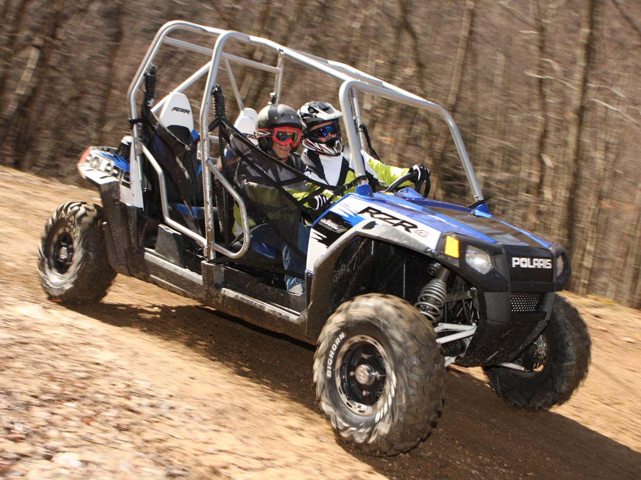 2010.polaris.rzr4_.blue_.front-right.riding.on-dirt.jpg
