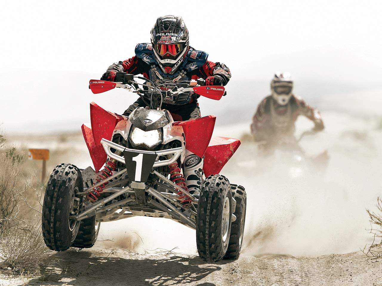 2011.polaris.outlaw525irs.red_.front_.riding.on-dirt.jpg