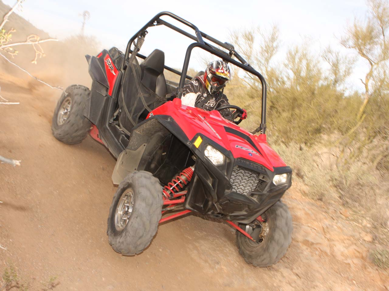 2011.polaris.rzr-xp900.red_.front-right.riding.on-dirt.jpg