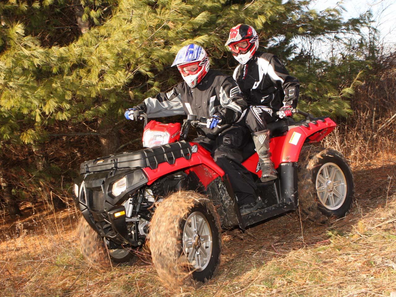 2011.polaris.sportsman-touring850eps.red_.left_.riding.in-woods.jpg