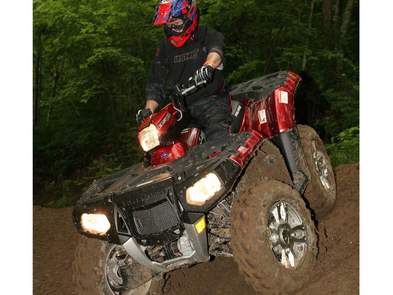 2011.polaris.sportsman-xp850.red_.front_.riding.on-dirt.jpg
