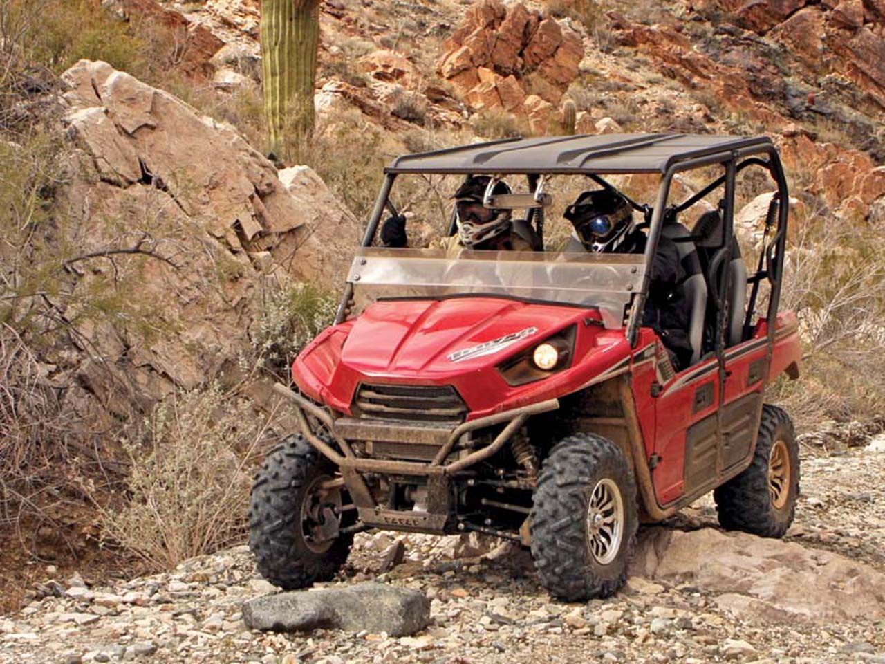 2012.kawasaki.teryx4_.red_.front-left.riding.on-path.jpg