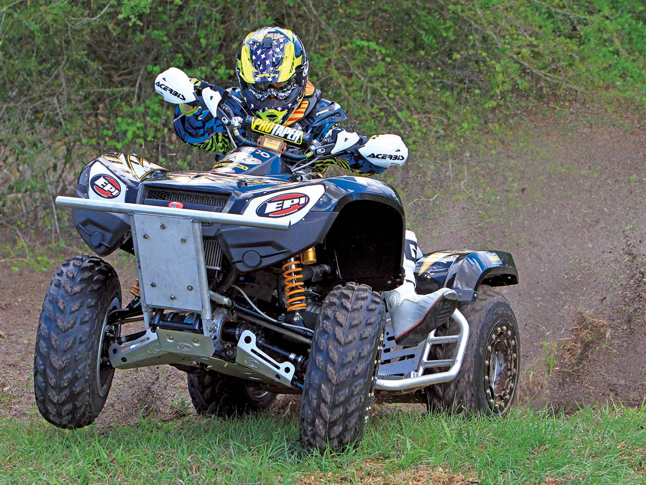 2012.kymco_.mxu450i.taylor-stoddard.front_.racing.on-grass.jpg
