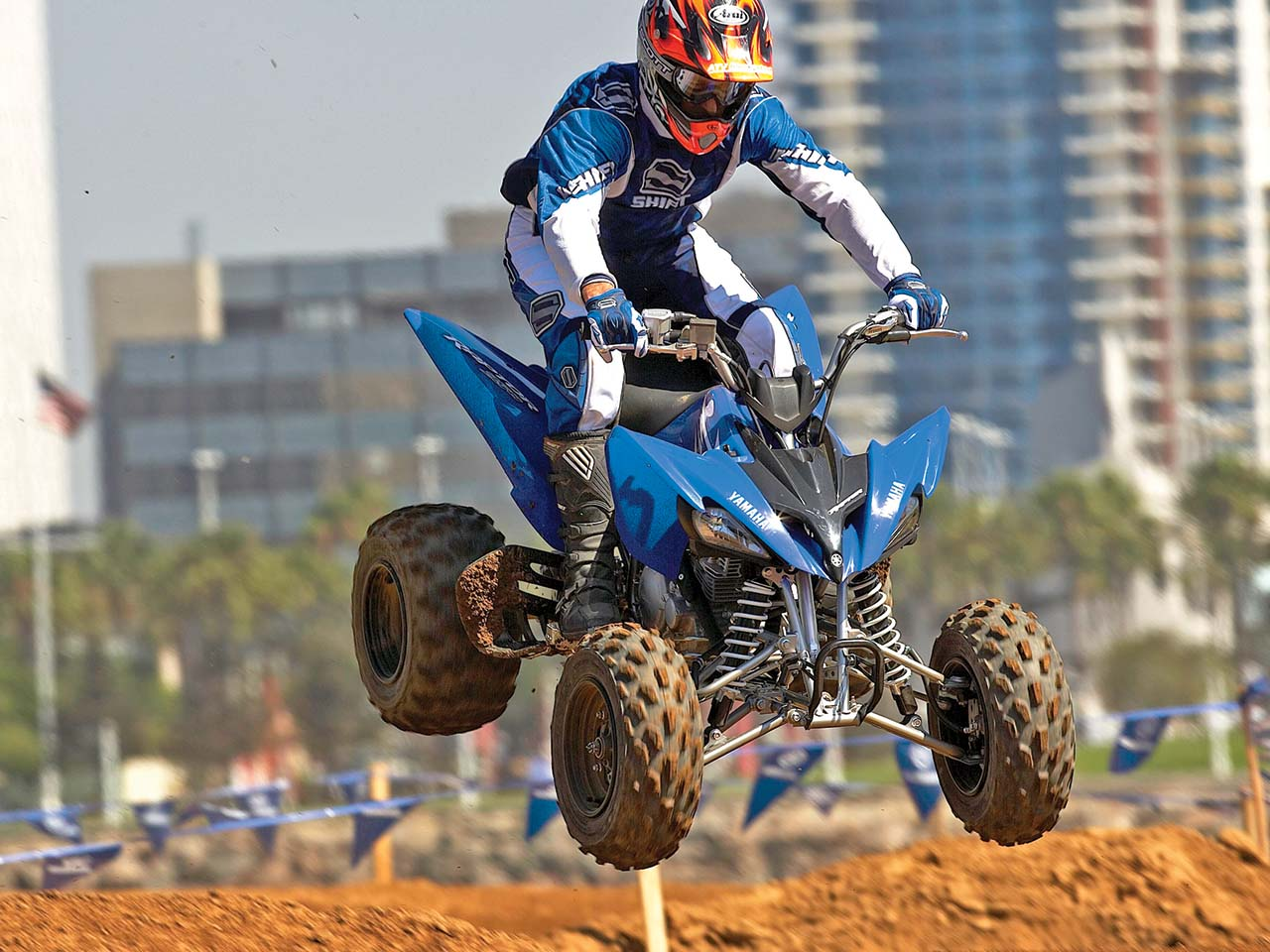 2012.yamaha.raptor250.blue_.front_.jumping.in-air.jpg