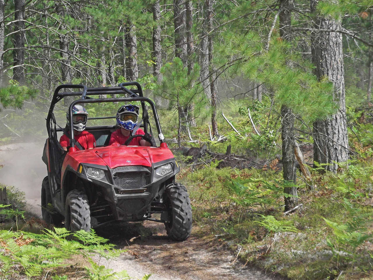 2013.polaris.rzr570.red_.front-right.riding.on-trail.JPG