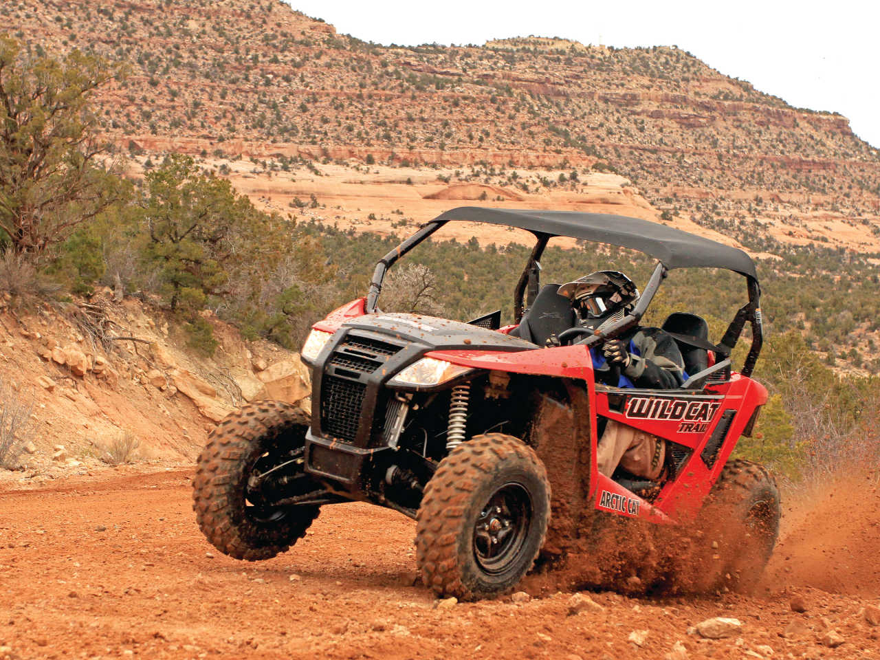 2014.arctic-cat.wildcat-trail-xt.front-left.red_.riding.on-dirt.JPG