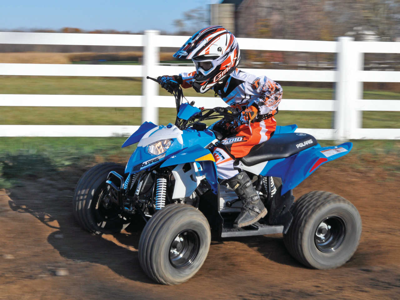 2014 polaris outlaw90 front-left blue_ riding on-