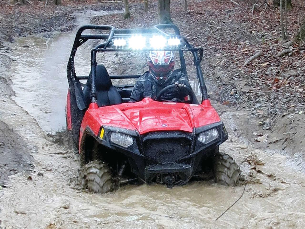 2014.polaris.rzr_.red_.front_.riding.through-mud.JPG