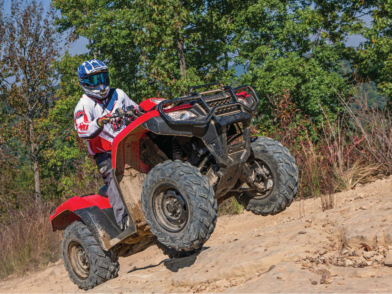 2015.honda_.fourtrax-foreman-rubicon.red_.front-right.riding.wheelie.jpg
