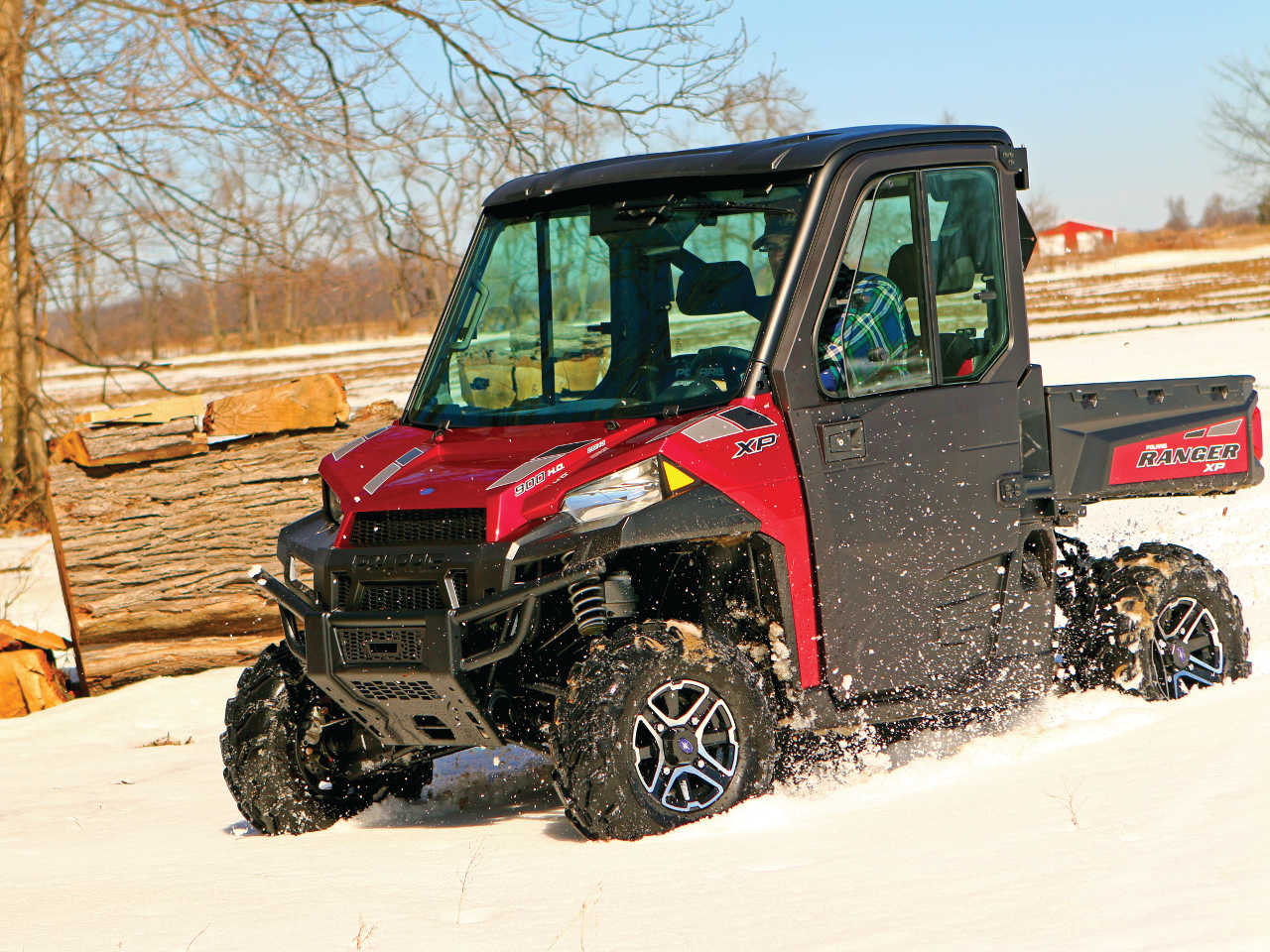 2015.polaris.ranger-xp900northstar.red_.front-left.riding.on-snow.jpg