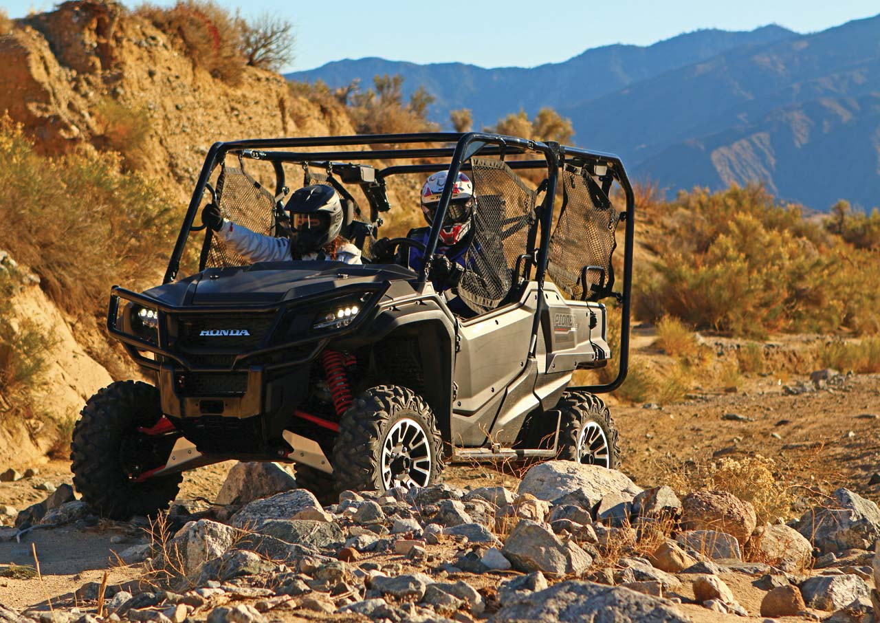 2017.honda_.pioneer1000-5deluxe.grey_.front-left.riding.on-trail.jpg