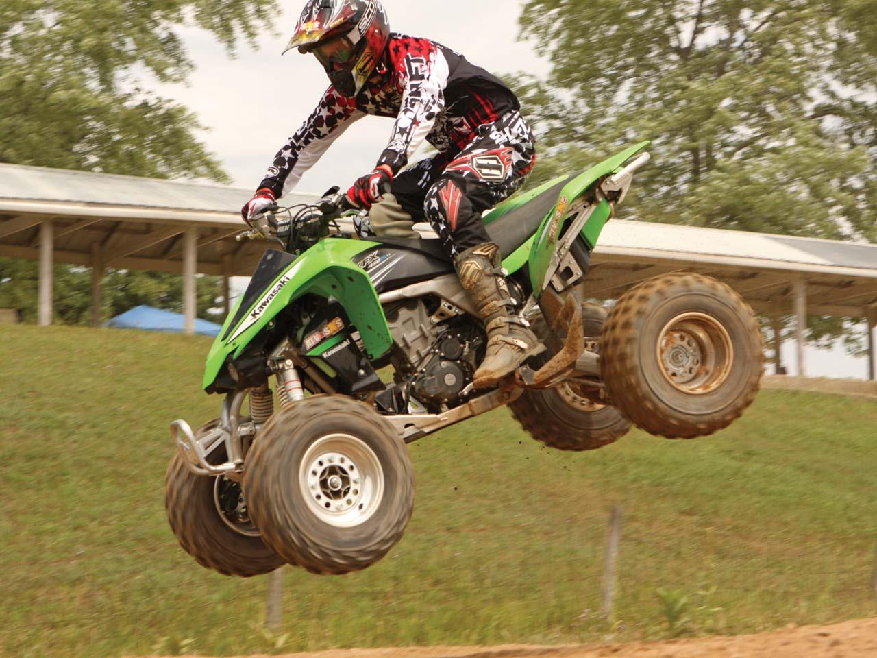 Filename 2011 kawasaki kfx450r left_ green_ jumping through air jpg