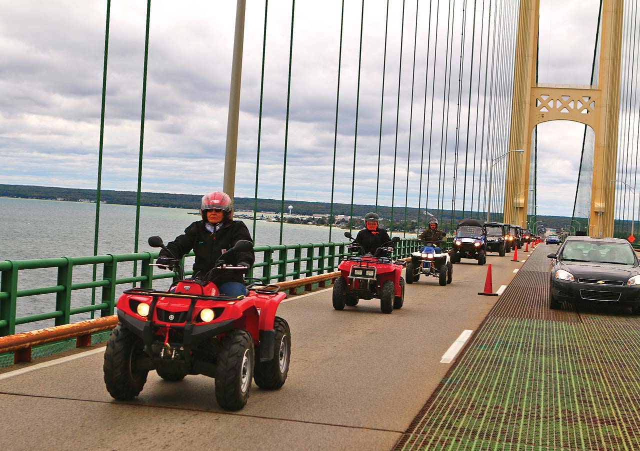 location.2016.saint-ignance-michigan.atv-crossing-mackinac-bridge.atvs-riding-on-bridge.jpg