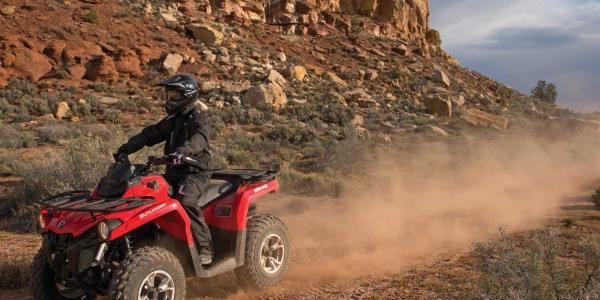 2015.can-am.outlander-l450.red_.front-left.riding.on-dirt.jpg