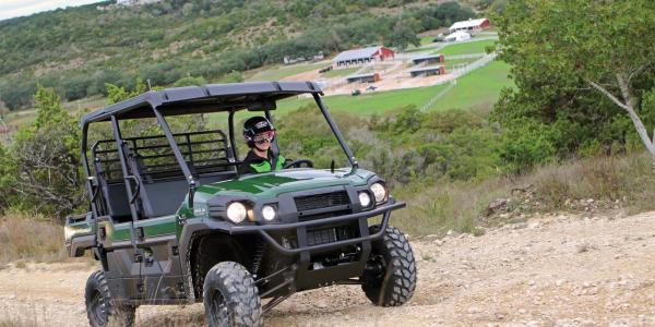 2016.kawasaki.mule-pro-dxt-diesel.green.front-right.riding.on-dirt-road.jpg