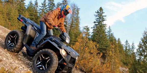 2016.polaris.sportsman570sp.black.right.riding.on-rocks.jpg