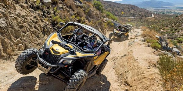 2017.can-am.maverick-x3.front.yellow.riding.on-trail.jpg