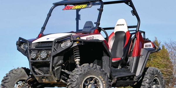 vendor.2014.superatv.polaris-rzr.lift-kit.white-and-red.custom-rzr.parked.on-dirt.jpg