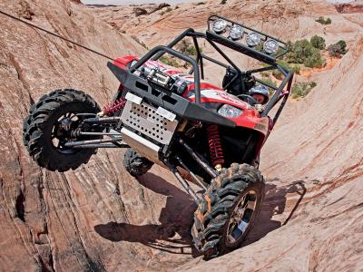2010.kawasaki.teryx_.red_.front_.using-winch.over-rocks.jpg