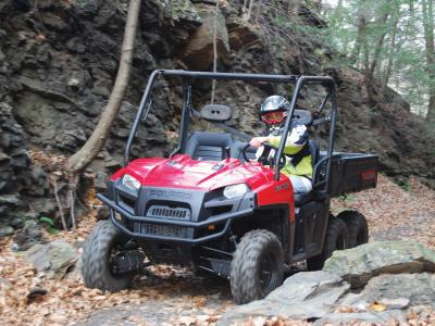 2010.polaris.ranger6x6.red_.front-left.riding.on-trail.jpg