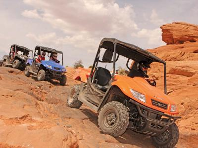 2012.kymco.uxv500i.orange.front-right.riding.over-rocks.jpg