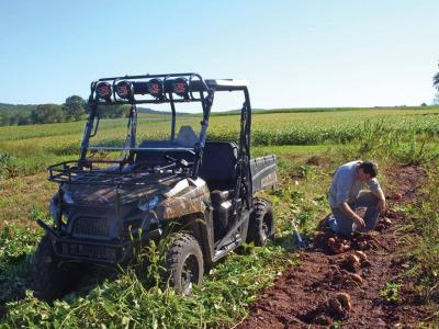 2012.polaris.ranger500.camo.front-left.parked.on-field.jpg