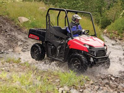 2012.polaris.ranger500efi.red_.front-right.riding.through-water.jpg