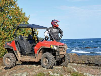 2012.polaris.rzr570.red_.right_.parked.on-rocks.jpg