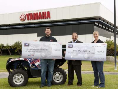 2012.yamaha.charity.holding-checks.jpg