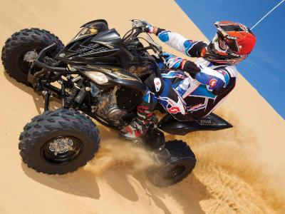 2012.yamaha.raptor700.black_.front-left.riding.on-sand.jpg