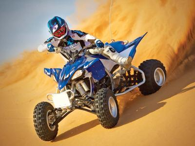 2012.yamaha.yfz450.blue.front-left.riding.on-sand.jpg