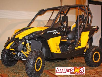2013.can-am.maverick1000r.yellow.front-left.parked.in-doors.jpg