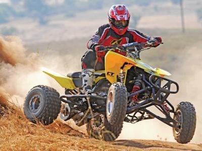 2013.suzuki.ltr450.yellow.front-right.riding.on-dirt.jpg