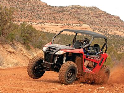 2014.arctic-cat.wildcat-trail-xt.front-left.red.riding.on-dirt.JPG