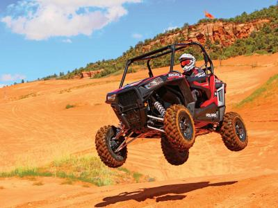 2015.polaris.rzr-s900.red_.front-left.jumping.in-air.jpg