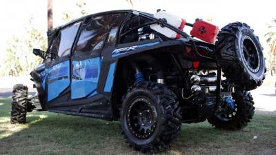 2015.polaris.rzr-xp4-1000custom.rear-left.blue_.parked.on-grass.jpg