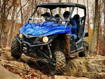 2015.yamaha.wolverine.blue_.front-left.riding.over-rocks.jpg