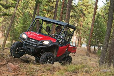 2016.honda.pioneer1000.red.front-left.riding.in-woods.jpg
