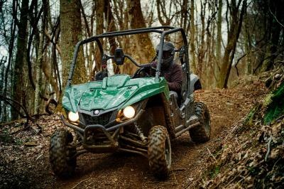 2016.yamaha.wolverine.green.front-left.riding.in-woods.jpg