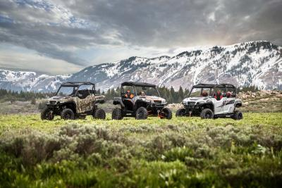2017.polaris.general.family-group-photo.parked.on-grass.jpg