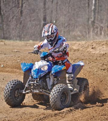 2017.polaris.outlaw110.front-left.blue_.riding.on-dirt.jpg