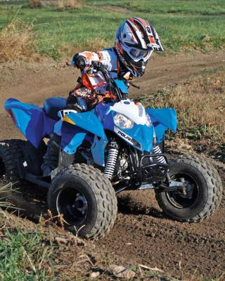 2017.polaris.outlaw110.front-right.blue_.riding.on-dirt.jpg