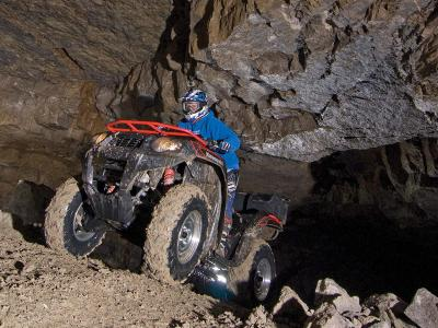 location.2012.mines-and-meadows.kawasaki.brute-force750.front-left.riding.through-mines.jpg