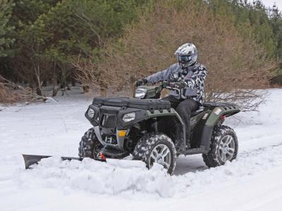 vendor.2010.polaris.atv-plow.front-left.plowing.snow_.jpg