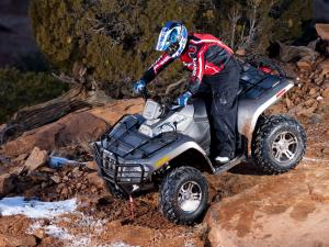 2010.arctic-cat.550h1efi.silver.left_.riding.over-rocks.jpg