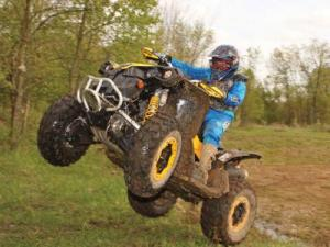 2010.can-am.renegade800x-xc.yellow.front-left.jumping.in-air.jpg