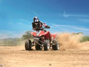 2010.hyosung.te450s.red_.front_.riding.on-sand.jpg