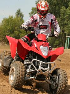 2010.kymco_.mongoose300.red_.front_.riding.on-dirt.jpg
