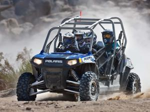 2010.polaris.rzr4_.blue_.front-left.riding.on-dirt.jpg